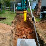 Dobson Excavations Excavating Rock with Rock Hammer